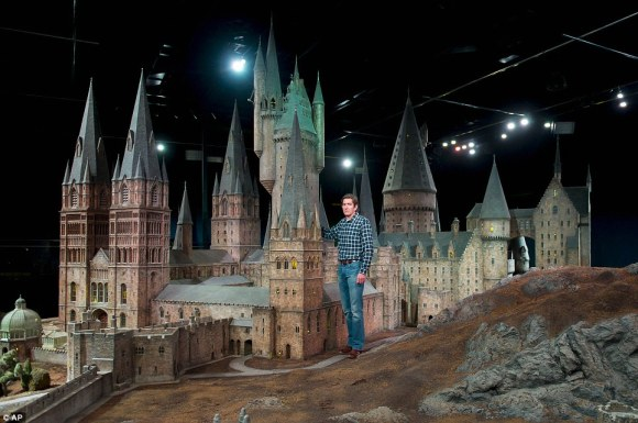 From the Daily Mail article: Proud: Jose Granell, model supervisor, is pictured with the model of Hogwarts Castle. It has been used for every one of the Harry Potter films.