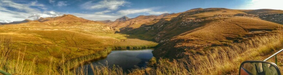 An experimental HDR panorama of a watering hole set in the mountains